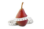 Sweet pear with measuring tape isolated on white background