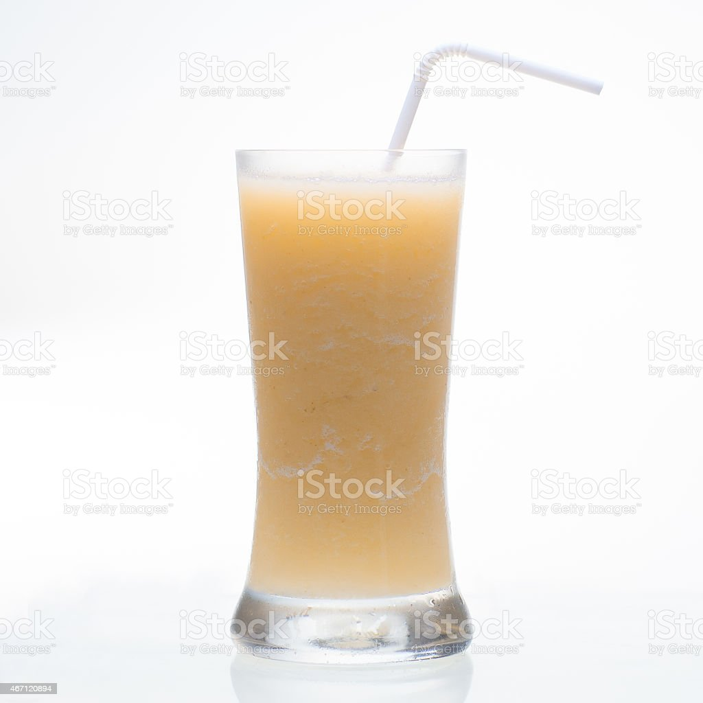 Sweet pineapple shake drink in glass isolated on white stock photo