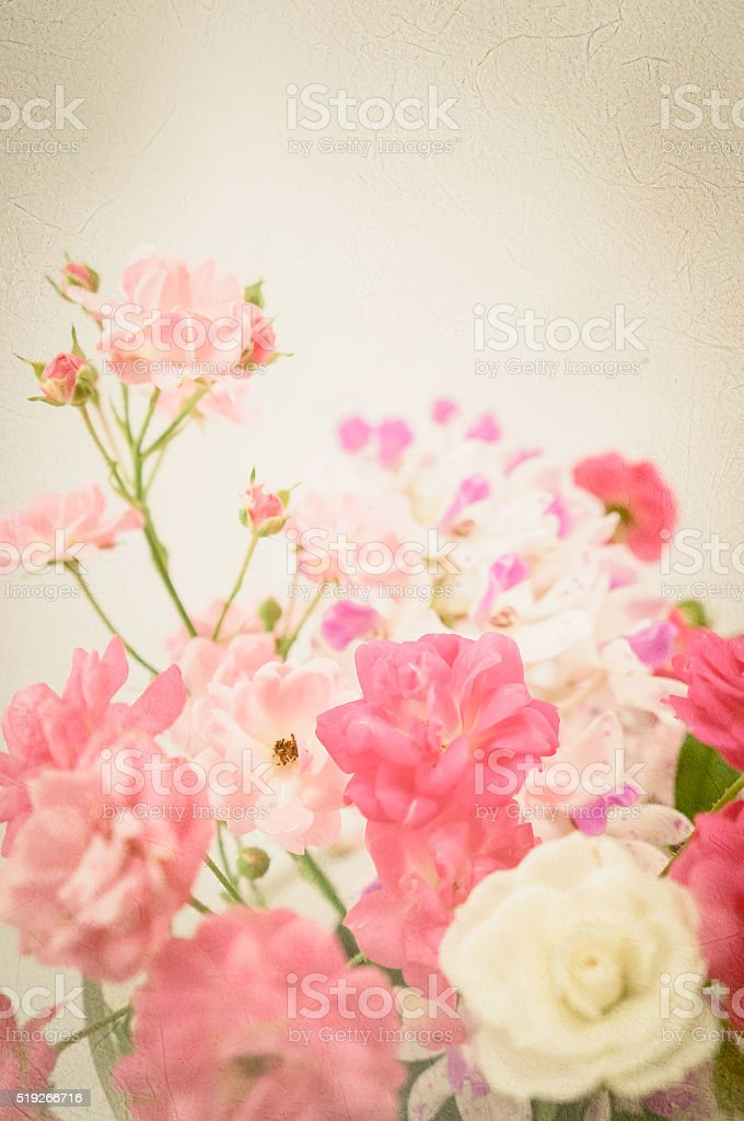 sweet pink roses in soft color on mulberry paper texture stock photo