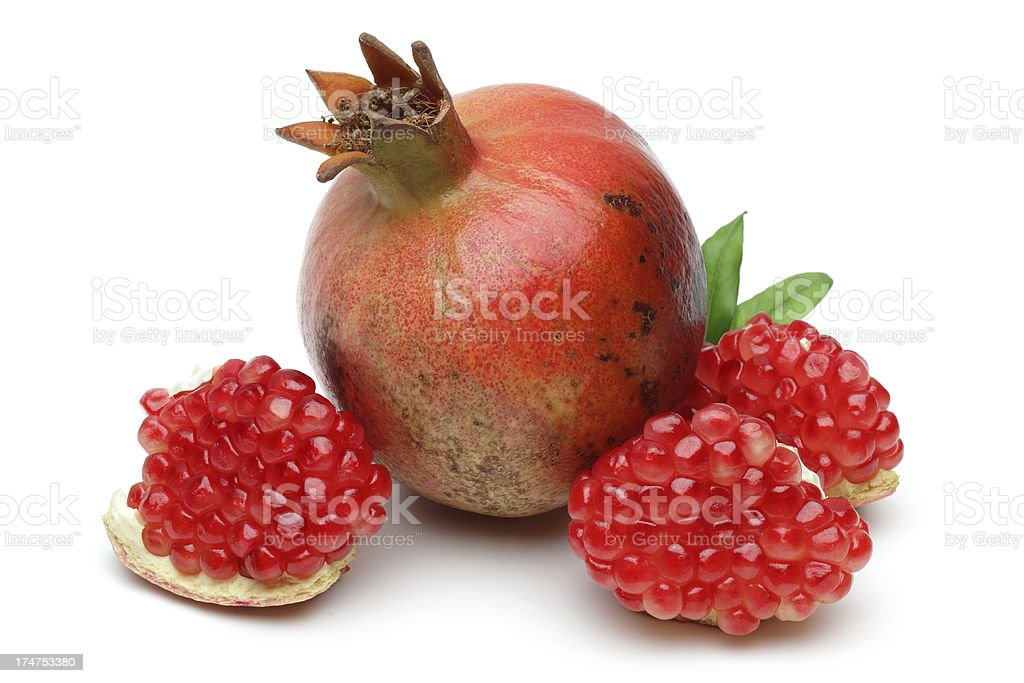 Sweet pomegranate with leafs royalty-free stock photo