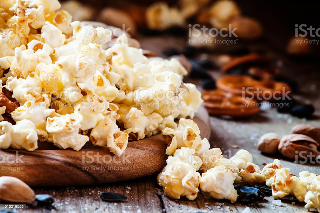 Sweet popcorn, salted cookies, sunflower seeds stock photo