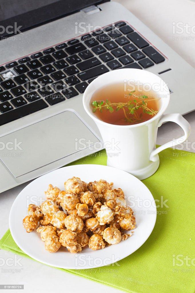 sweet popcorn still life computer, laptop stock photo