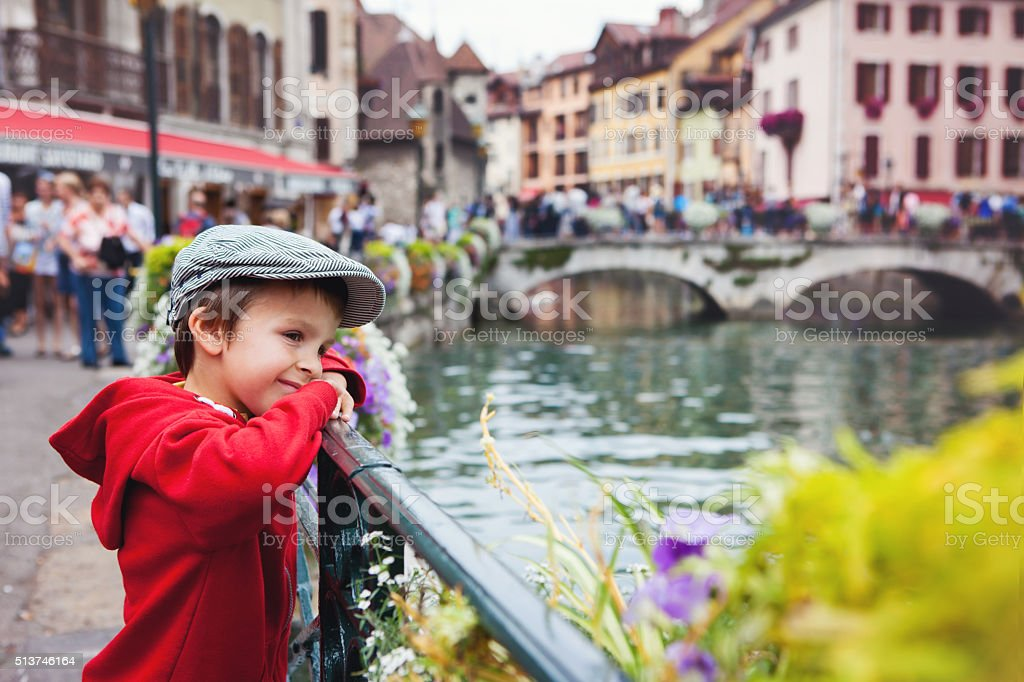 Sweet portrait of preschool boy in the town of Annecy stock photo