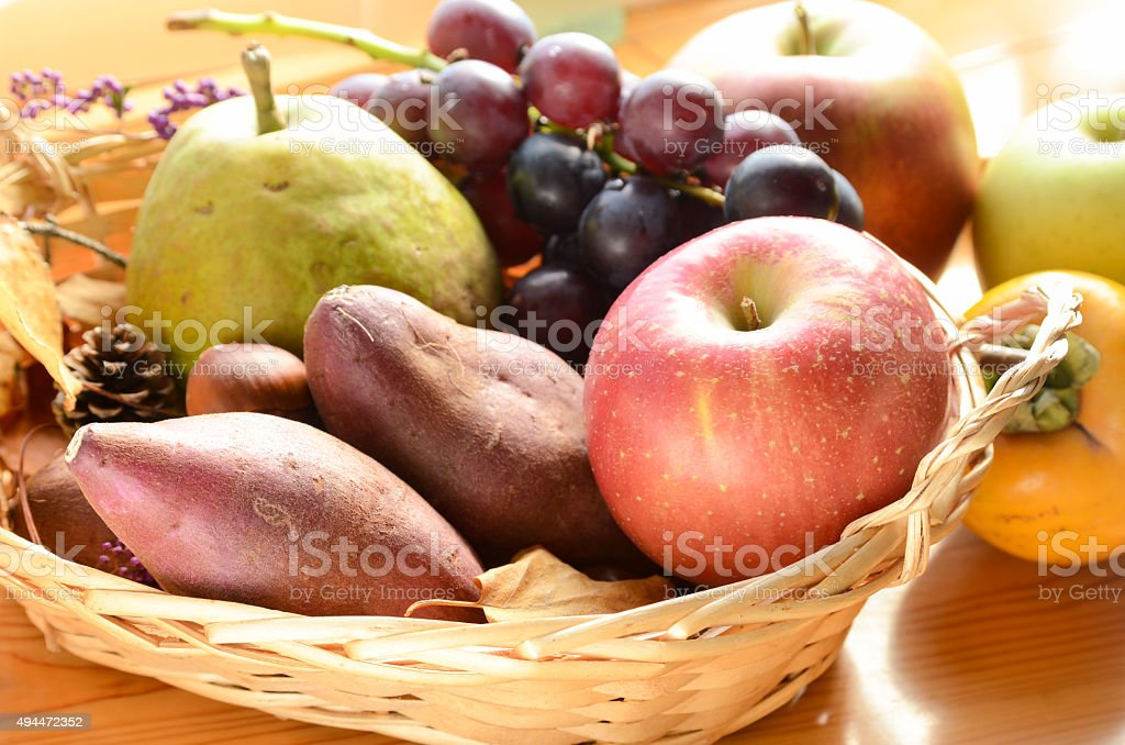 sweet potato and fruits in autumn stock photo