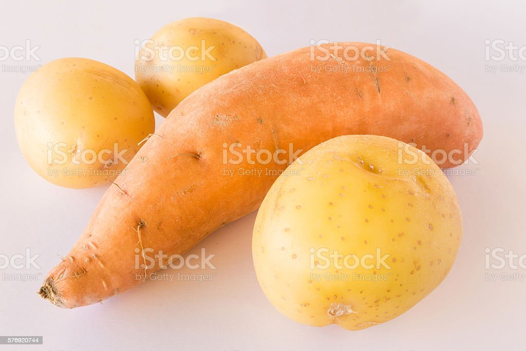 Sweet potato and potatoes on white background stock photo
