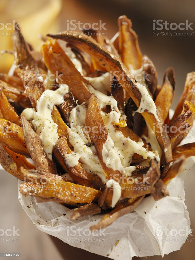 Sweet Potato French Fries with Garlic Herb Mayonnaise royalty-free stock photo