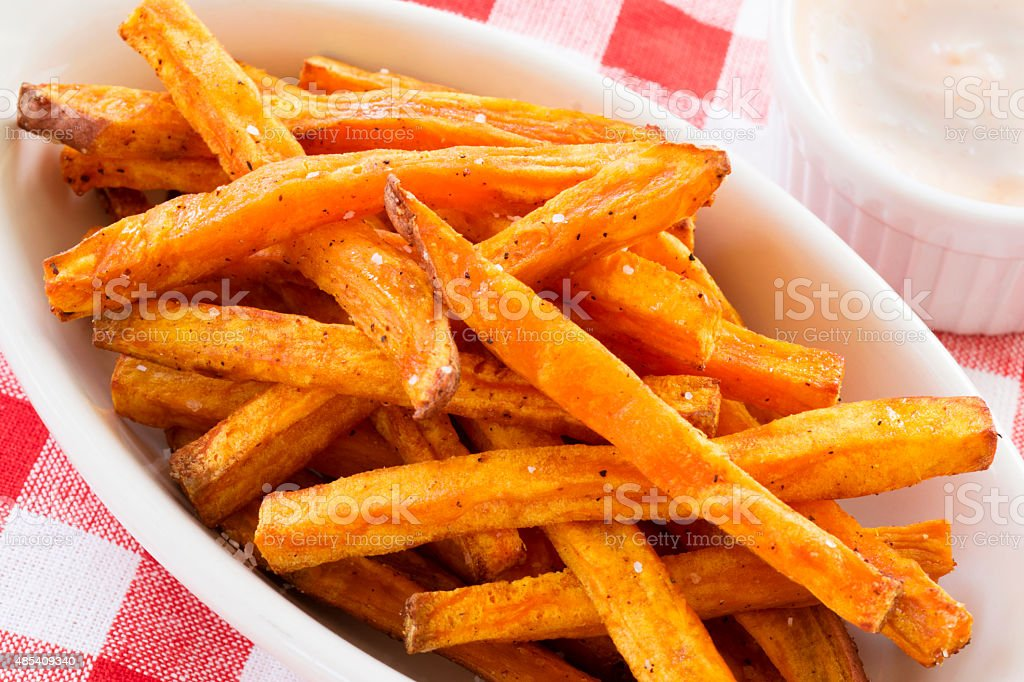 sweet potato fries with dip and checkered napkin stock photo