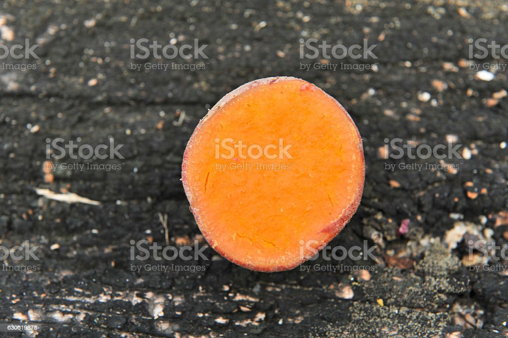 sweet potato on wooden background stock photo