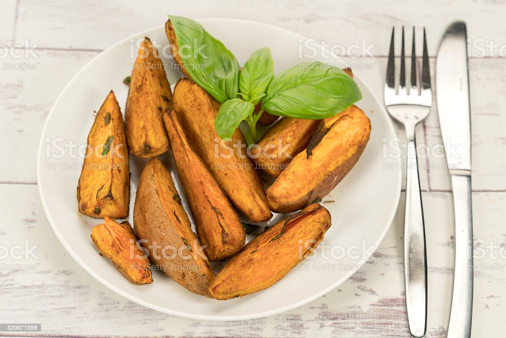 Sweet potato wedges stock photo