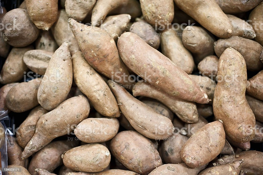 Sweet potatoes background stock photo
