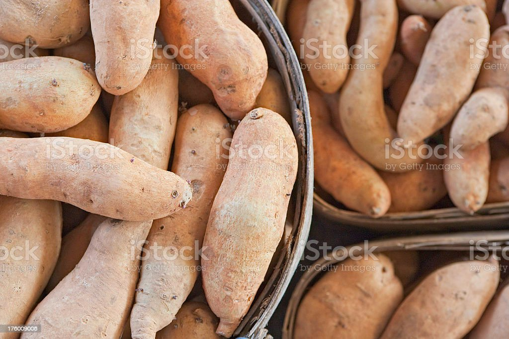 Sweet potatoes for sale (XXL) royalty-free stock photo