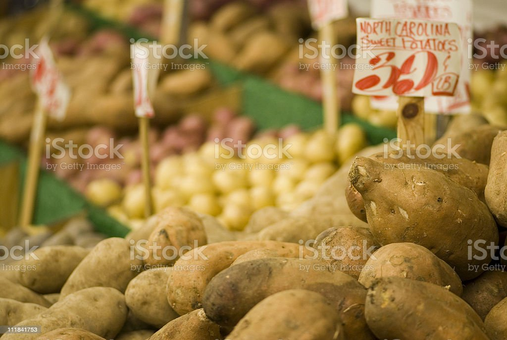 Sweet potatoes in the market stall stock photo