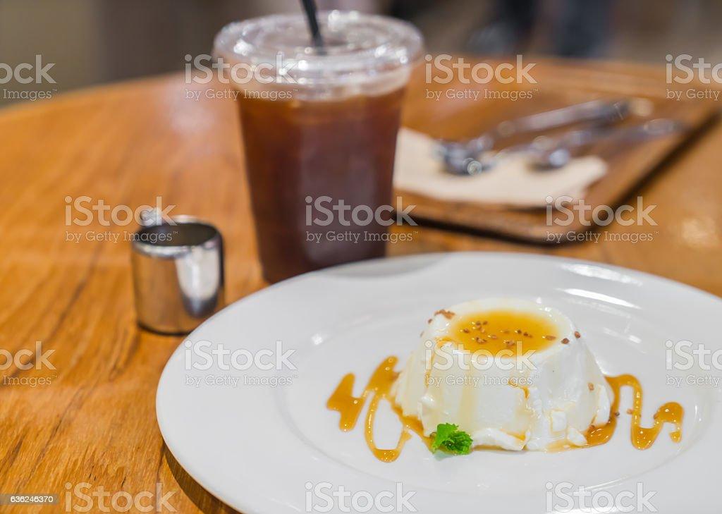 Sweet pudding with orange sauce stock photo
