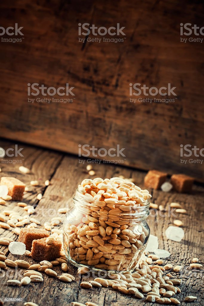 Sweet puffed rice with caramel in a glass jar stock photo