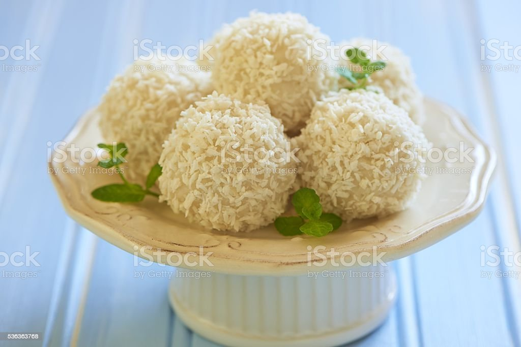 Sweet rice and coconut balls with nut stock photo