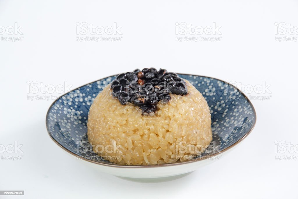 sweet rice cakes and black beans stock photo
