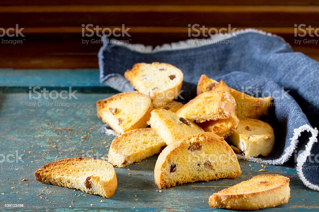 Sweet rusk bread on old wooden background. stock photo