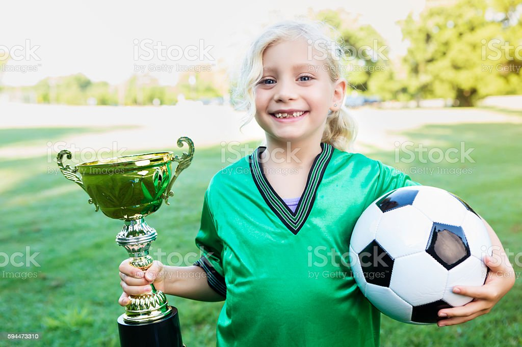 Sweet soccer player with championship trophy stock photo