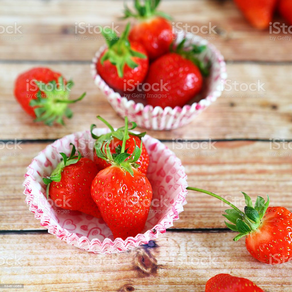 Sweet strawberries in the cake pans stock photo