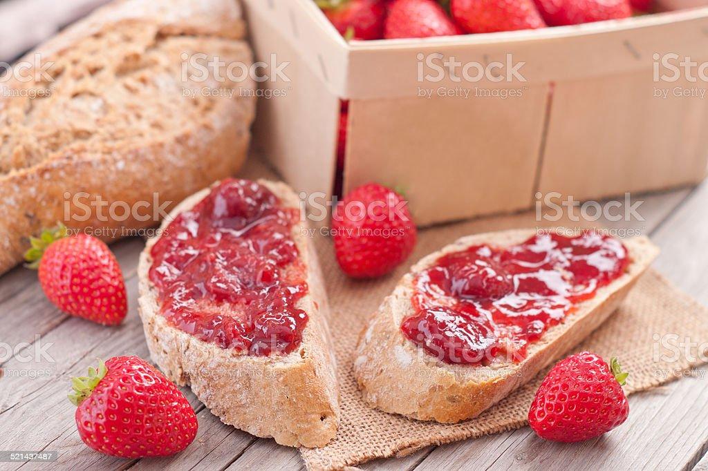 sweet strawberries jam on bread slice. stock photo