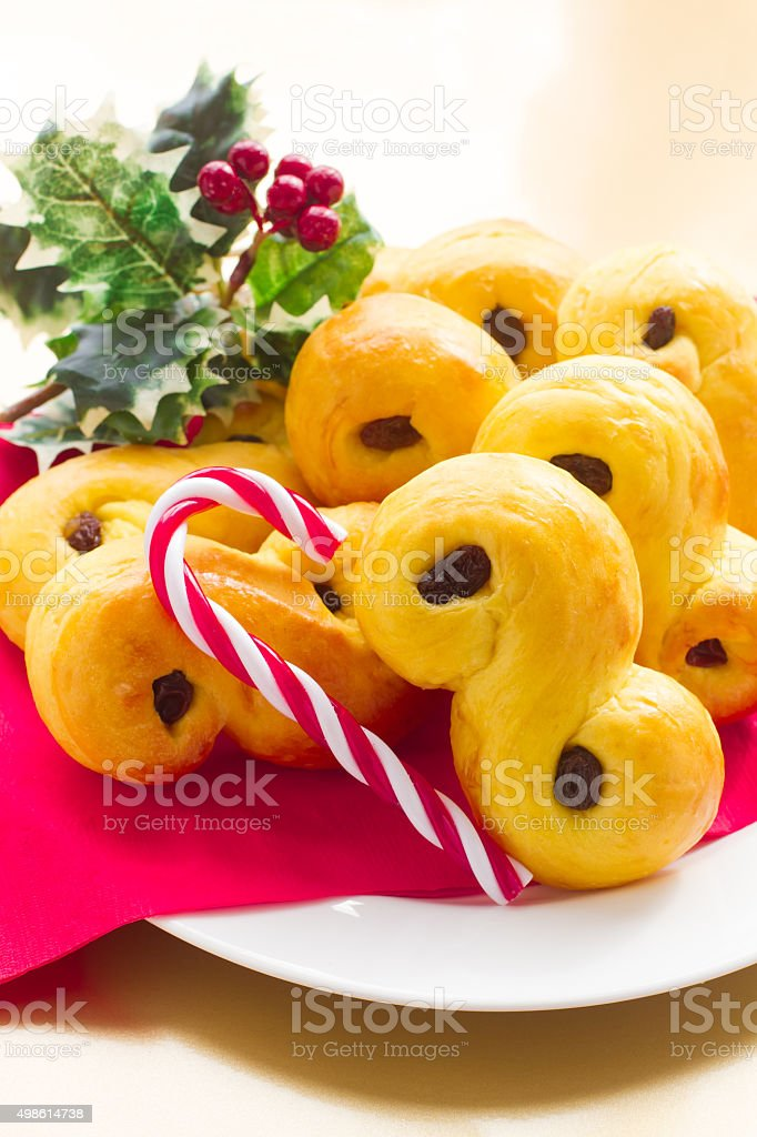 Sweet Swedish buns baked with saffron, cranberries and raisins stock photo