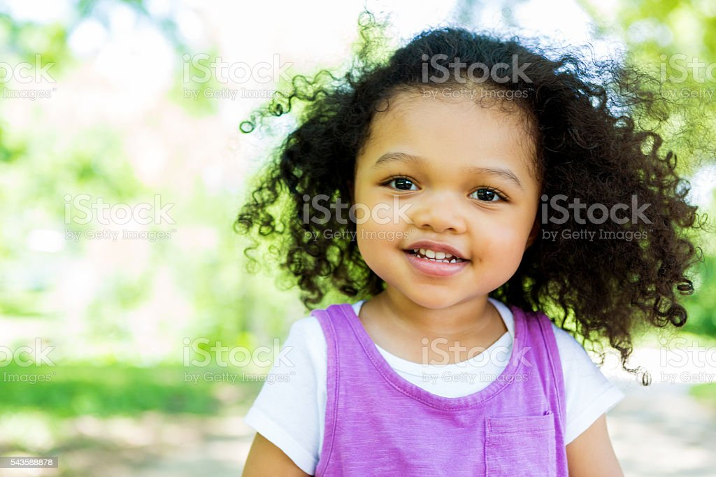 Sweet toddler in the park on a summer day stock photo