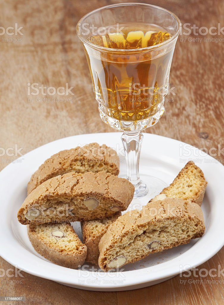 sweet white wine and italian almond cantuccini on table royalty-free stock photo