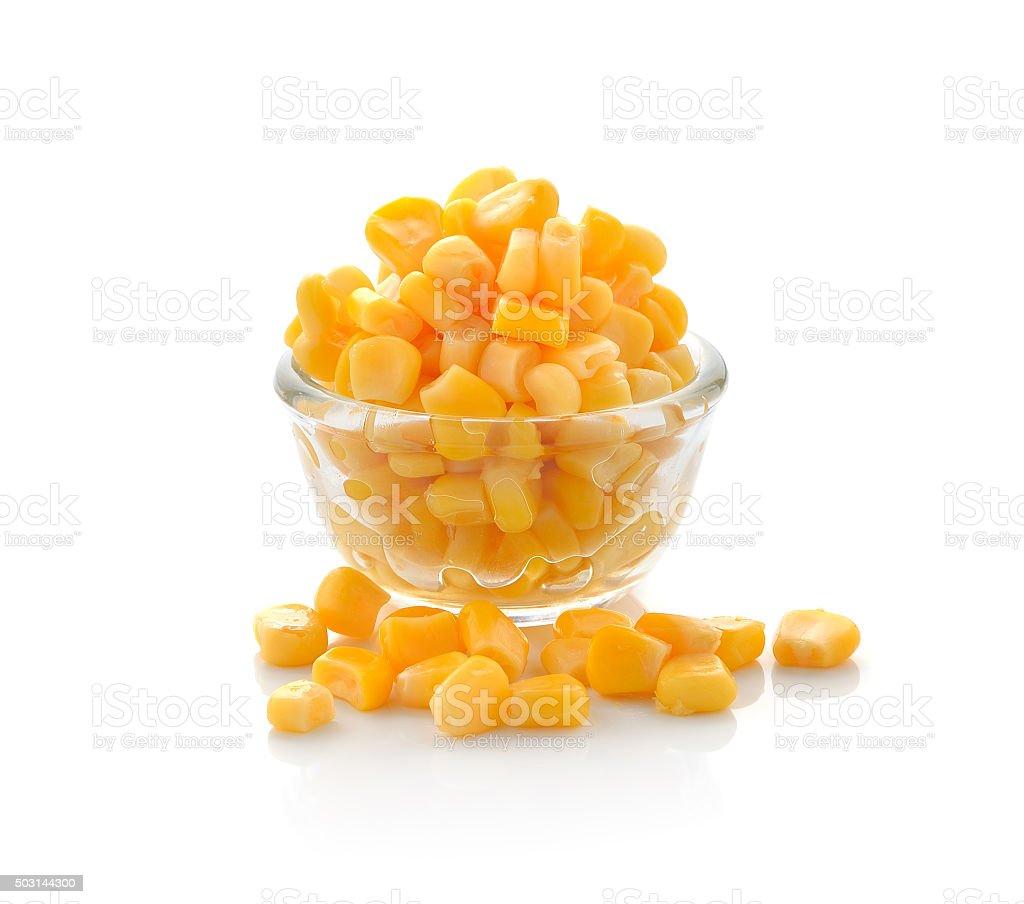 Sweet whole kernel corn on white background stock photo