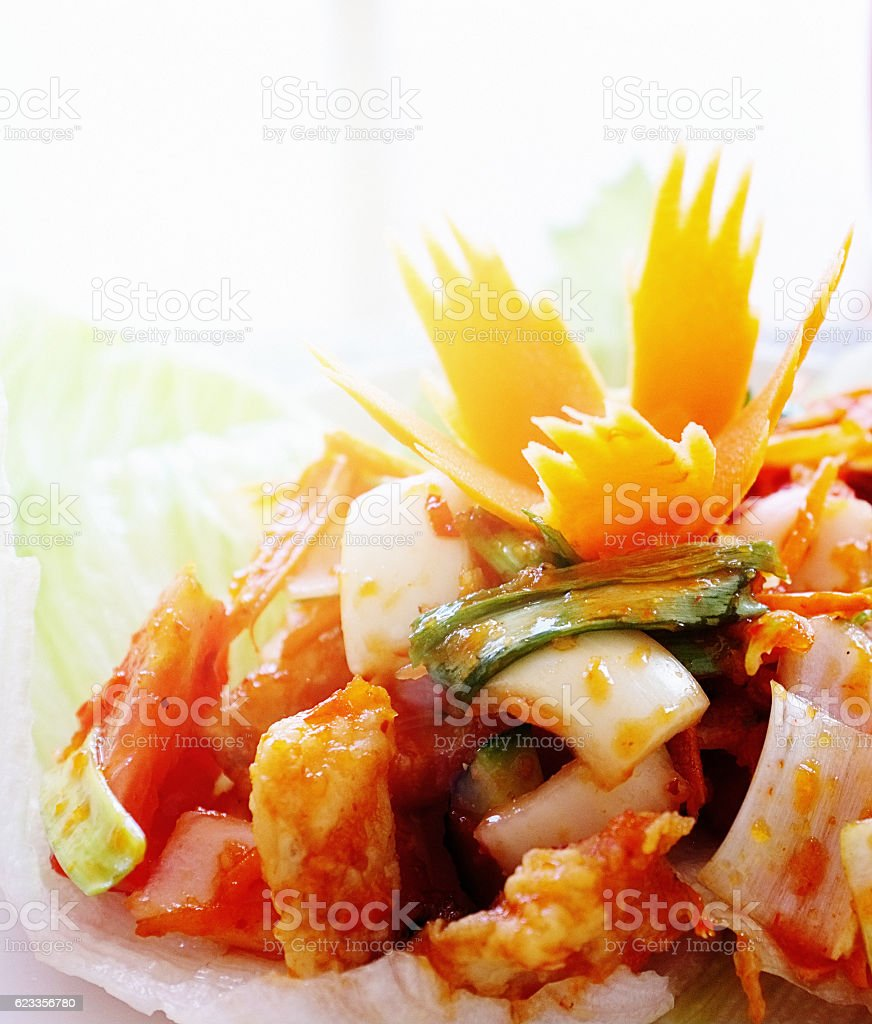 Sweet-and-sour Thai fish salad  with carrot garnish stock photo