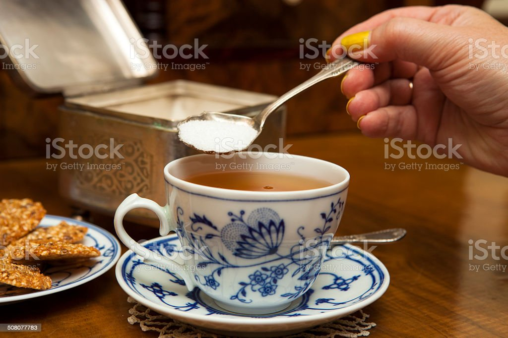 Sweetening tea stock photo