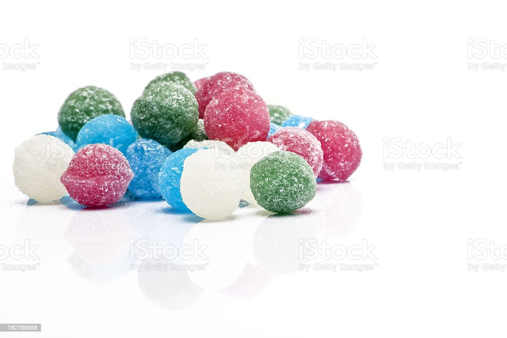 Sweets Sugar Candy Balls on Glossy White Background royalty-free stock photo