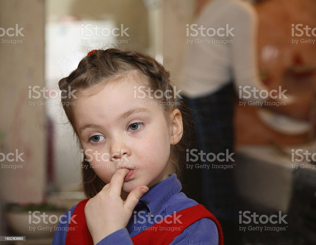 Sweet-tooth girl in the kitchen royalty-free stock photo