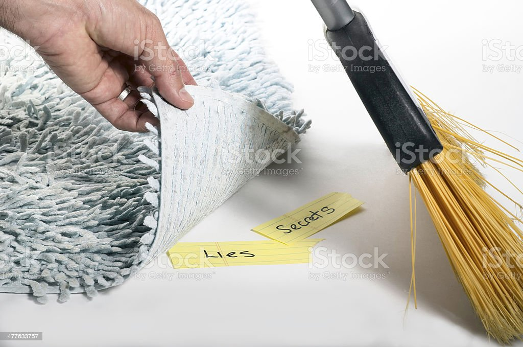 Swept under the rug stock photo