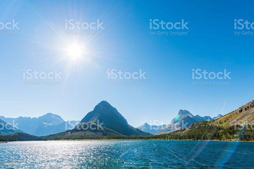 Swiftcurrent Lake Montana Glacier National Park Scenic Blue Water Landscape stock photo