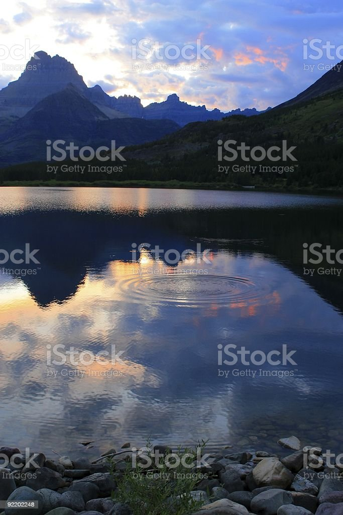 Swiftcurrent Lake sunset, glassy royalty-free stock photo