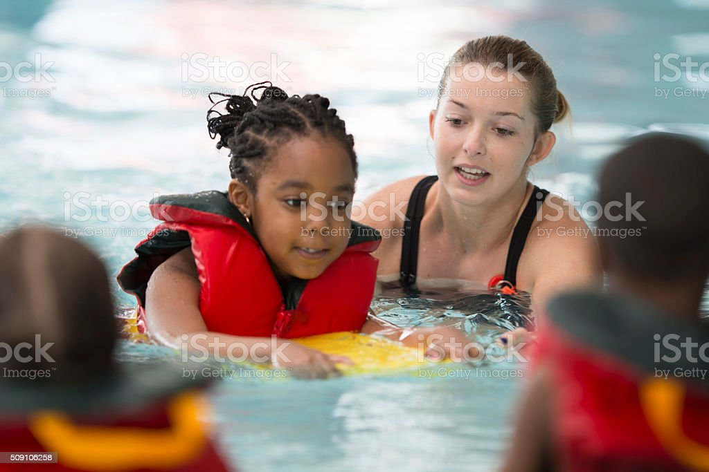 Swim Instructor Working with a Little Girl stock photo