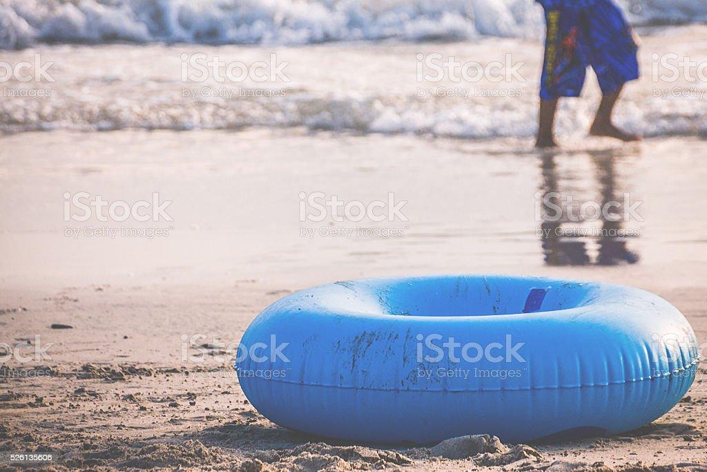 Swim Ring On Sandy Beach stock photo