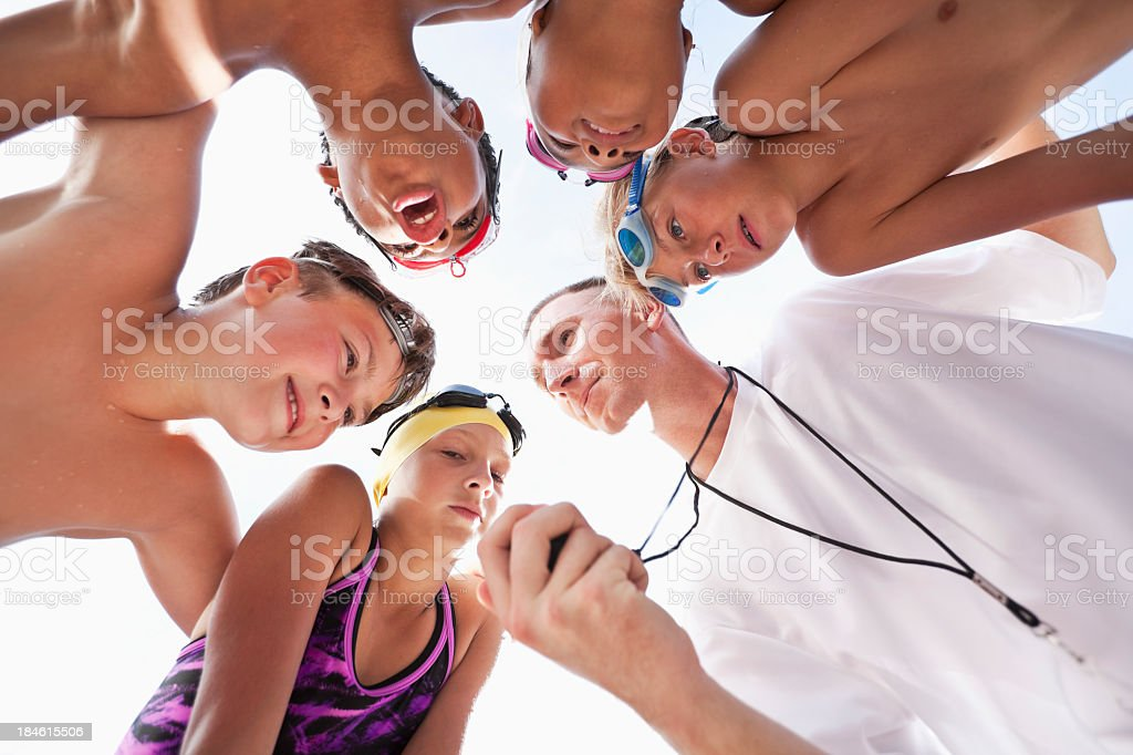 Swim team in a huddle stock photo