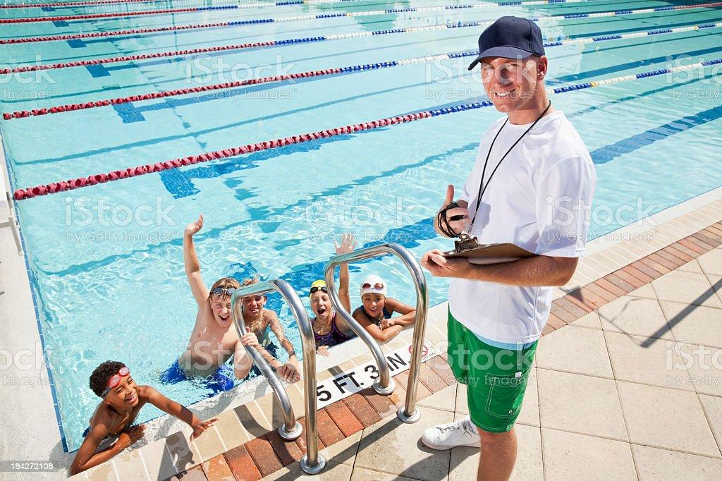 Swim team with coach royalty-free stock photo