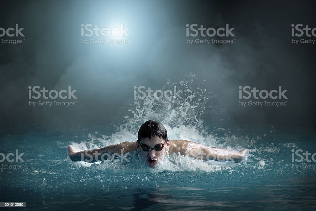 Swimer in waterpool. Butterfly style of swimming. stock photo