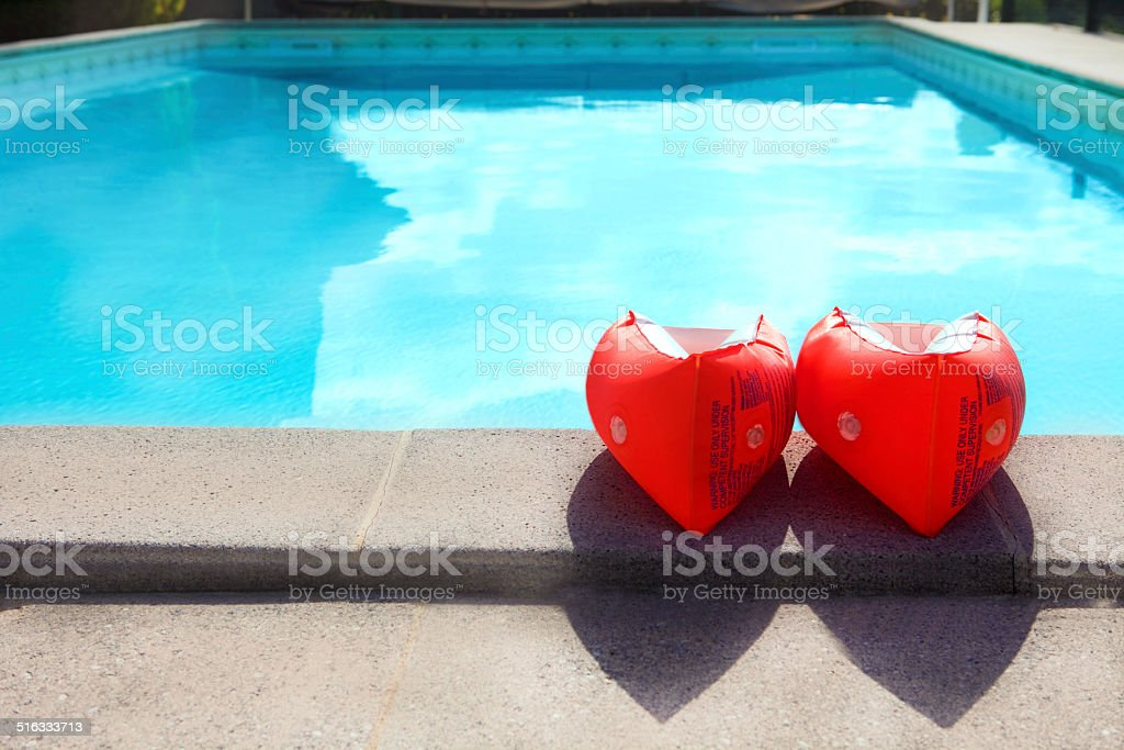 Swiming pool and water wings stock photo