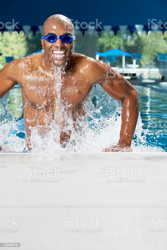 Swimmer getting out of pool stock photo