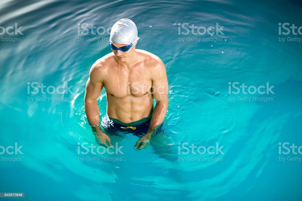 Swimmer in cap and glasses stock photo
