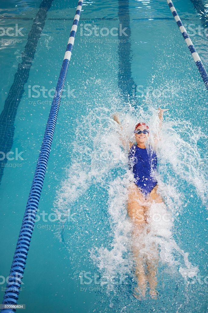 Swimmer in pool stock photo