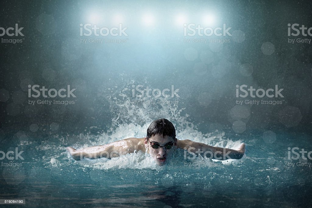 Swimmer in waterpool stock photo