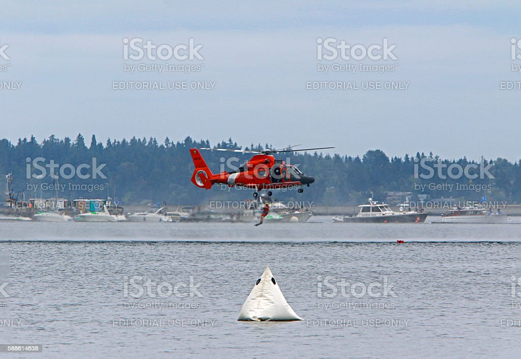 Swimmer jumping from Coast Guard Copter stock photo