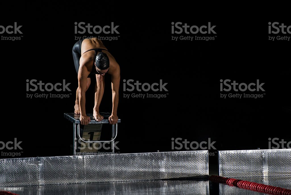 Swimmer On A Swimming Starting Block stock photo