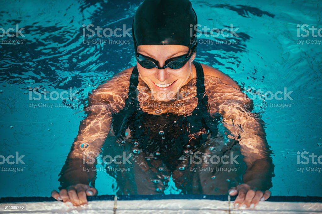 Swimmer on pool edge stock photo