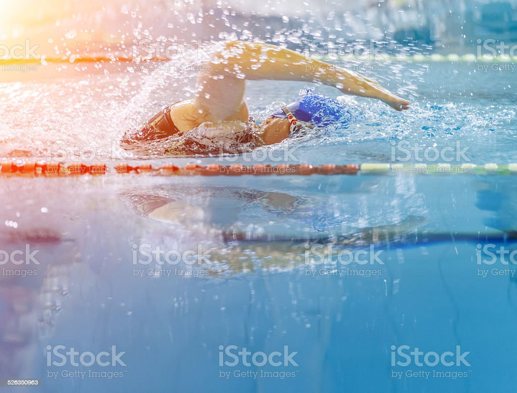 Swimmer racing in the swimming pool stock photo