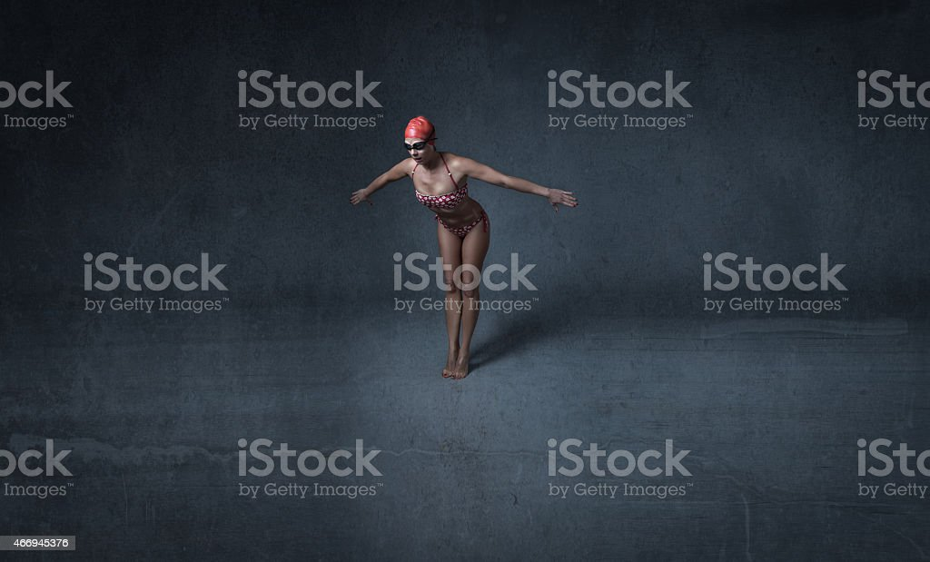 swimmer ready to dipping start stock photo
